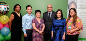 Case Manager Michelle Gordon, Valedictorian Aaron Antonio, RN, CARE Centre Executive Director Dr. Ruth Lee, Alexander Bezzina, Deputy Minister, Ontario Ministry of Citizenship and Immigration, 2015 IEN of the Year Kareen Tacderas, RN, and Case Manager Lourdes Vicente.